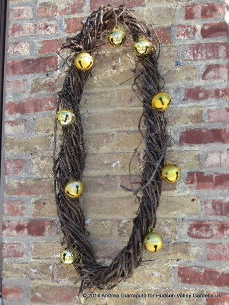 Handmade grape vine wreath with Christmas bells at Kiss My Feet Salon