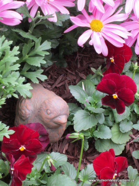 Bird sculpture with pansies and chrysanthemums, www.HudsonValleyGardens.us