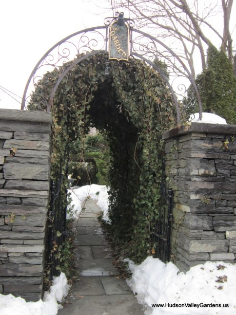 Garden with blue stone wall and ivy arch, www.HudsonValleyGardens.us