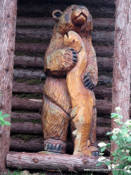 Wooden sculpture, bear and salmon, www.HudsonValleyGardens.us