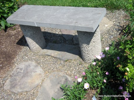 Garden bench made from concrete uprights with a bluestone slab on top