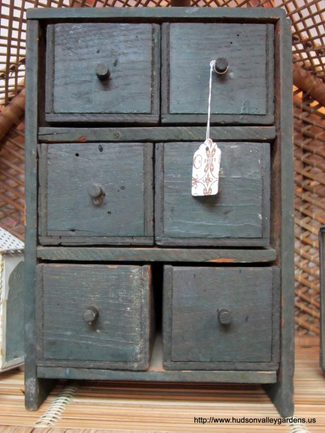 Dark blue mini cabinet with drawers