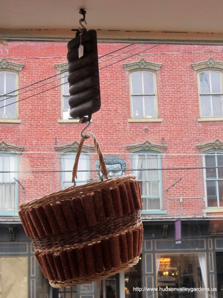 Vintage basket made from corn cobs hanging in the window of the shop