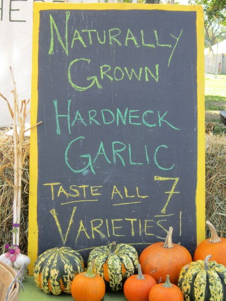 a chalk board sign advertising garlic by Wild Shepherd Farm at the Hudson Valley Garlic Festival