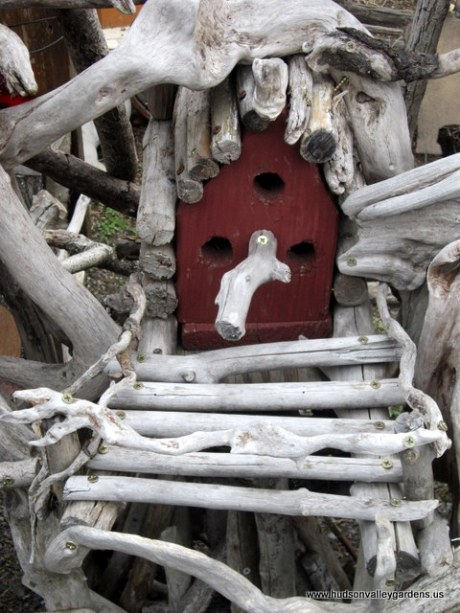Reclaimed bird house with miniature deck and hand-rails.