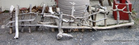 small, decorative garden fence, hand-made from driftwood.